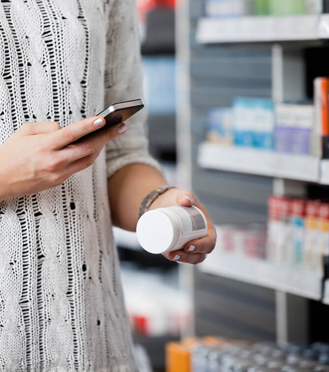 scanning medication in pharmacy with phone