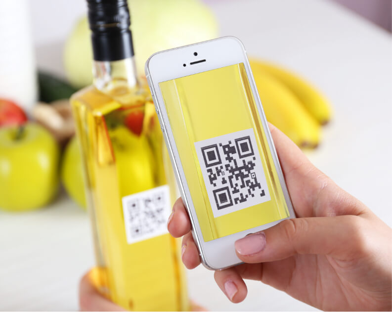 scanning oil bottle in kitchen with phone