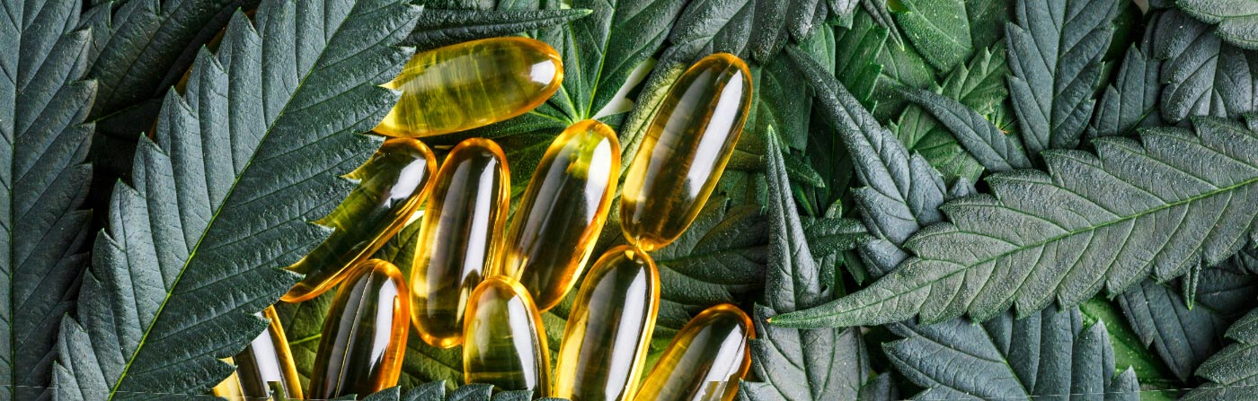 cannabis leaves and capsules