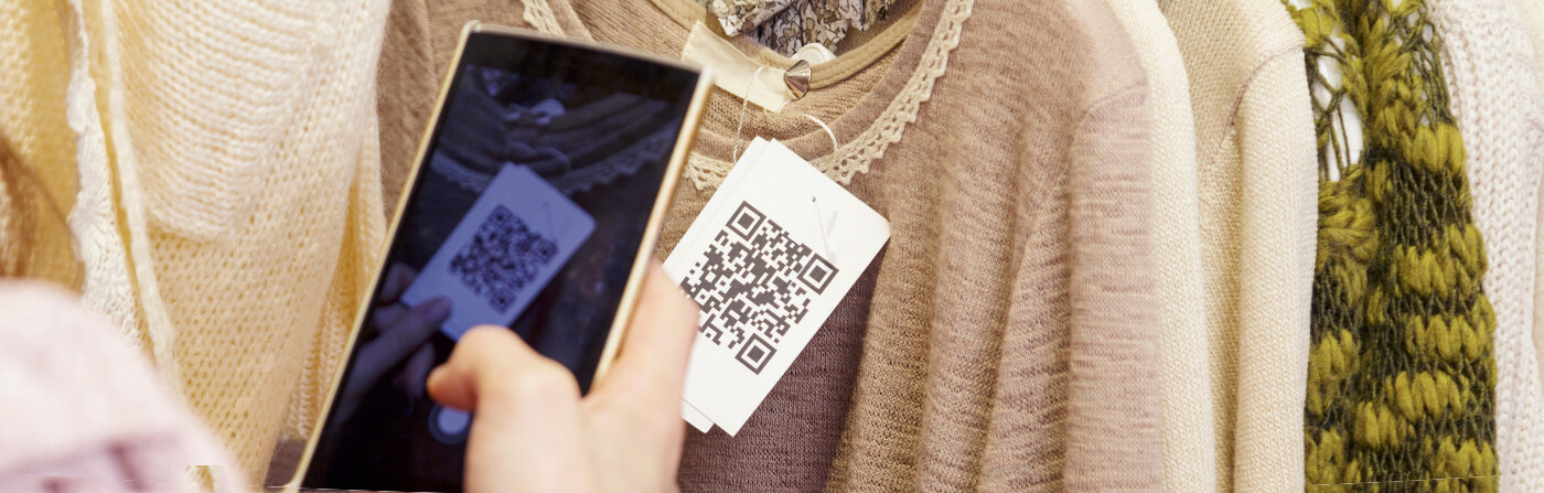 scanning a clothing tag qr code in a retail store with phone