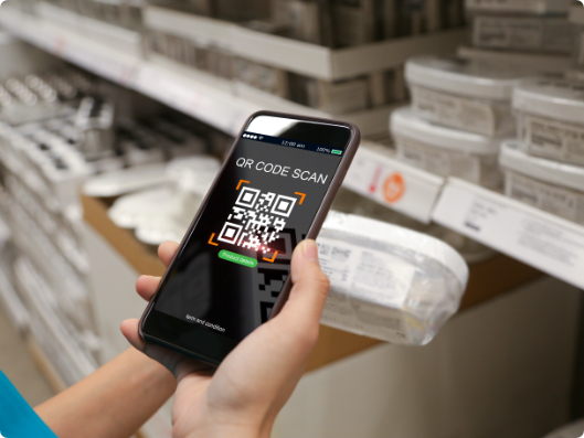 scanning groceries in store with phone