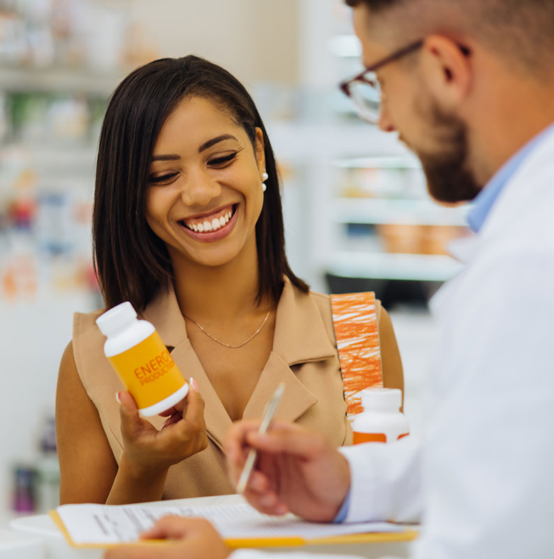 pharmacist talking to customer about nutraceuticals
