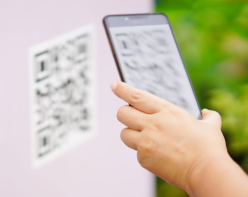 hand scanning qr code with smartphone